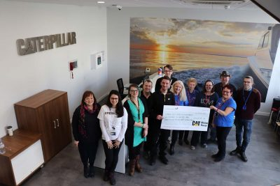 CMPUK celbrate donation to local MND Charity